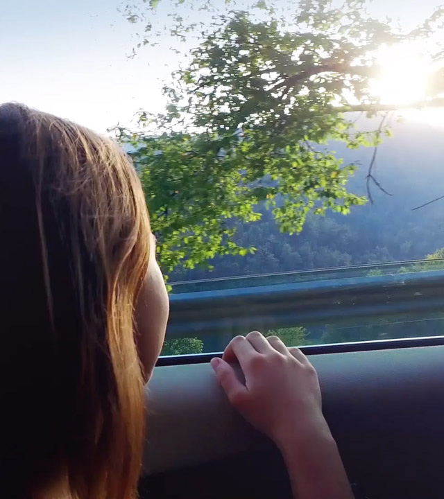 passenger in a car looking out the window