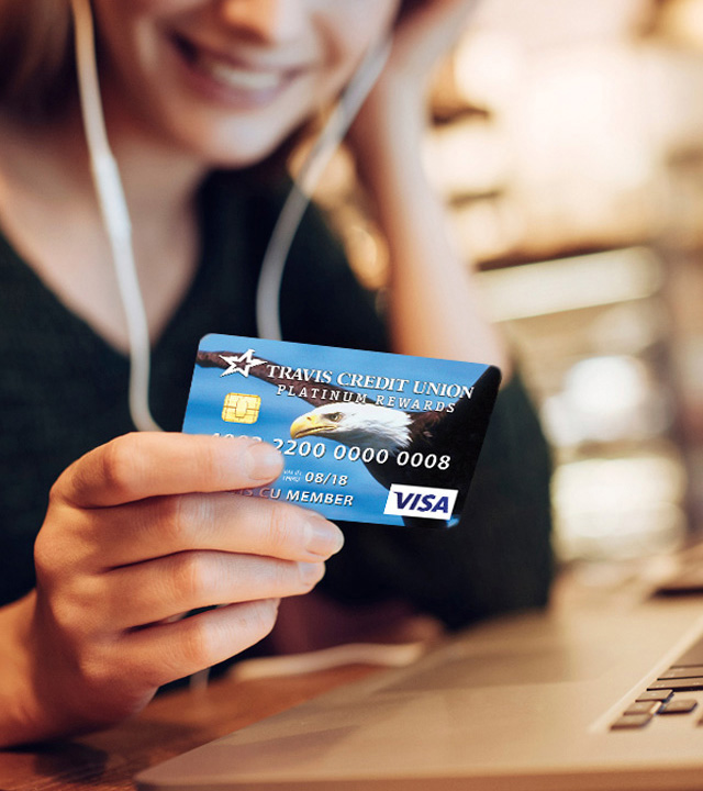 woman holding a Visa card